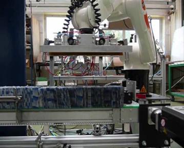 Poste de mise en pile et encartonnage de poches souples - robot